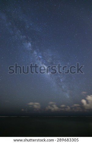 The milky way galaxy over open ocean as seen from the shore line of Oahu, Hawaii\'s south shore.