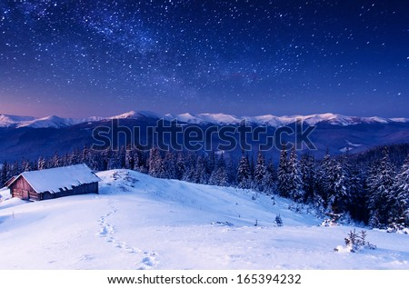 The Milky Way over the winter mountains landscape. Carpathian, Ukraine, Europe. Beauty world. #165394232