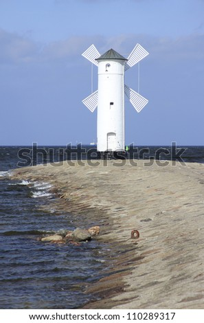 The mill beacon Swinoujscie (Poland) at the harbor entrance