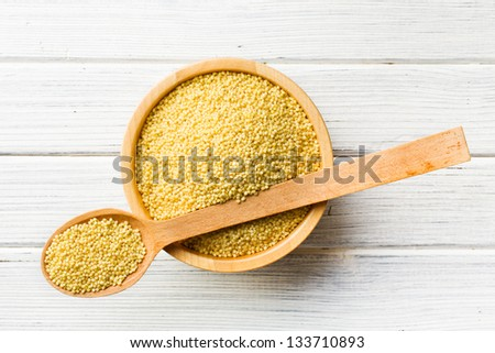 the millet in a wooden spoon