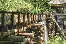 The Mingus Mill is a historic grist mill built in 1886 that uses a water powered turbine to power all the machinery in the building.  The water flows down the millrace to the mill.