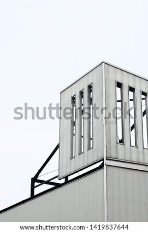The minimalist facade of a industrial building.