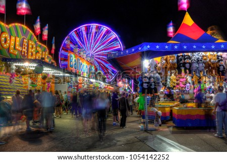 The Minnesota State fair is the largest gathering in Minnesota and millions of people attend during the two weed period. #1054142252
