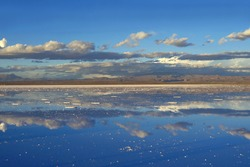 The Mirror Effect of Salar de Uyuni or Uyuni Salts Flats at the End of Rainy Season, UNESCO World Heritage Site in Bolivia, South America