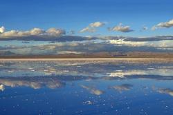 The Mirror Effect of Salar de Uyuni or Uyuni Salts Flats at the End of Rainy Season, UNESCO World Heritage Site in Bolivia, South America