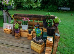 The Missouri homeowner utilized the back deck for a unique little quaint flower garden with various plants in pots. The little garden is an inexpensive way to enjoy nature.