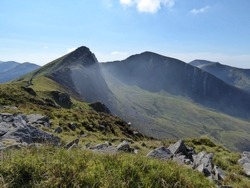The mist swirling beneath the rugged ridge of Y Garn, Nantlle Ridge - Snowdonia