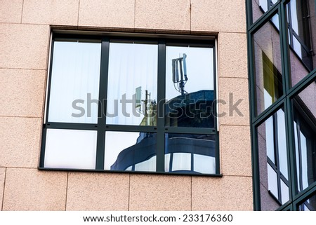 the mobile station of a mobile operator is reflected in a window. mobile transmitter and electromagnetic