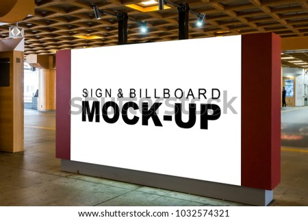 The mock up a large indoor signboard with clipping path, blank white space for advertising or information at the hall with spotlight