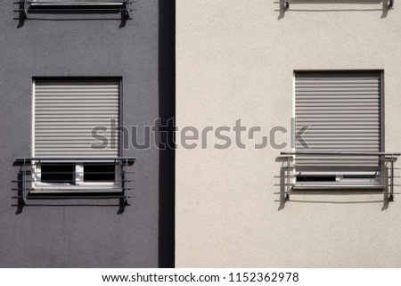 The modern facade of a modern residential building with windows and blinds.                             #1152362978