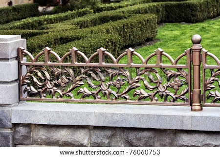 The Modern forged decorative fence with element casting .