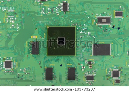The modern printed-circuit board with electronic components macro background. Mass production.  Logos and trademarks removed. There are only standard positional notation  and components values??.