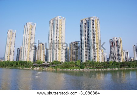 The modern residential apartment block with traditional style garden by river in Shanghai.