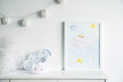 The modern scandinavian newborn baby room with mock up poster frame, white clouds and cotton lamps .