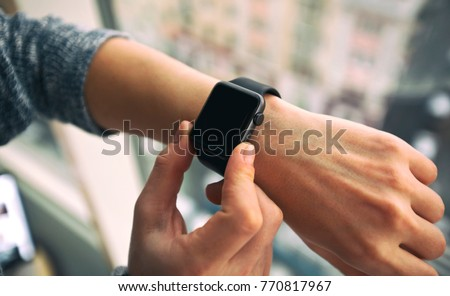 The modern smart watch on the woman's hand #770817967