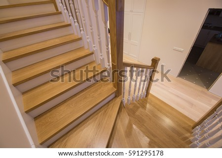 The modern two-storey bright apartment with wooden staircase #591295178