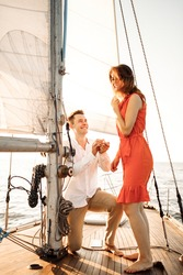 The moment of a marriage proposal on a yacht. Will you marry me. High quality photo