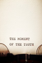 The moment of the truth phrase written with a typewriter.