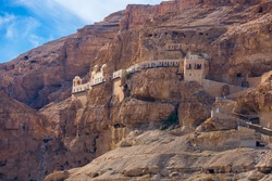 The Monastery of the Temptation on the red rocks. The Mount of Temptation in Jericho, Palestine. Greek Orthodox monastery. Judean desert