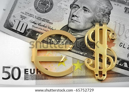 The money euro and dollars. Bundle of bank notes  and golden sign