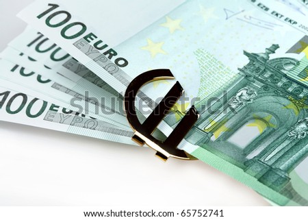 The money euro. Bundle of bank notes  and golden sign
