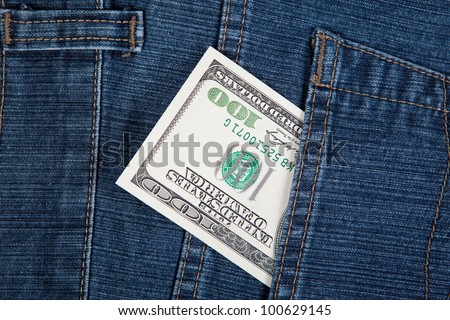 The money in a pocket of a denim