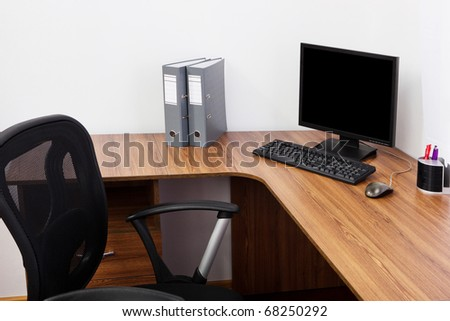 The monitor on a desk at modern office