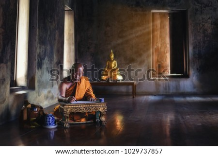 The monk is studying Buddhist activities.