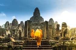 The monks in the ancient of Bayon temple, Angkor, Cambodia.