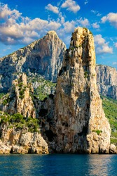 The monolith of Pedra Longa, Baunei, province of Ogliastra, East Sardinia, Italy. The rocky spire which rises majestically out of the sea. Holidays in Sardinia, Italy.