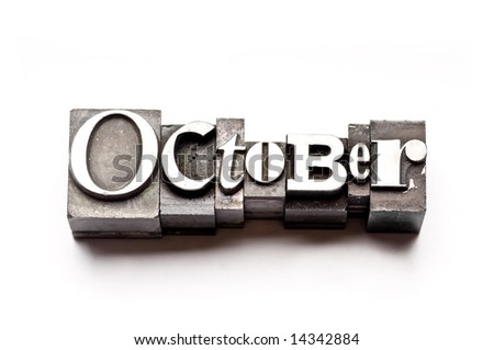 """The month of """"October"""" done in letterpress type on a white paper background. Part of a calendar series."""