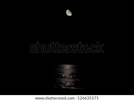 Stock Photo The moon and it's reflection in the Atlantic Ocean in Virginia Beach, VA.