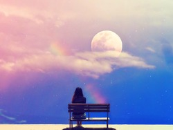 The moon and rainbow on beautiful pastel sky background.