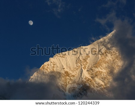 The Moon and slope of the Nuptse (7864 m) at sunset (view from Kala Patthar) - Nepal, Himalayas