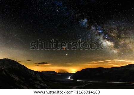The moon eclipse reveal the milky way in this beautiful mountain landscape at the National park of Gran Sasso, in Abruzzo #1166914180