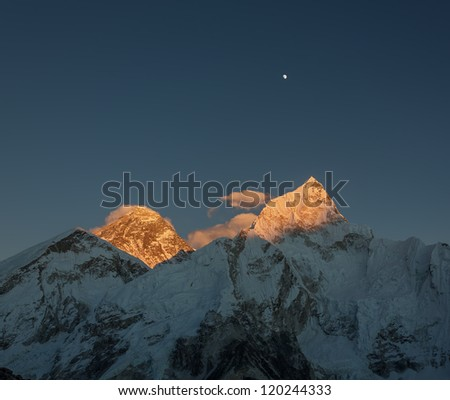 The Moon, Everest (8848 m), and Nuptse (7864 m) at sunset (view from Kala Patthar) - Nepal, Himalayas