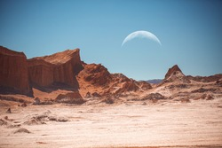 The moon in the Moon Valley in Atacama Desert, Chile