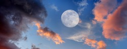 The Moon Is Rising In The Sky With Soft Clouds Set Against A Bright Blue Daytime Sky In Panorama Image Format