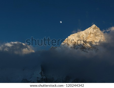 The Moon, Mount Everest (the highest peak in the world 8848m) and Nuptse (7864 m) at sunset (view from Kala Patthar) - Nepal, Himalayas