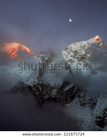 The Moon, Mt. Everest (8848 m), and Nuptse (7864 m) at sunset (view from Kala Patthar) - Nepal, Himalayas