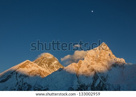 The Moon, Mt. Everest (8848 m), and Nuptse (7864 m) in the evening (view from Kala Patthar) - Nepal, Himalayas