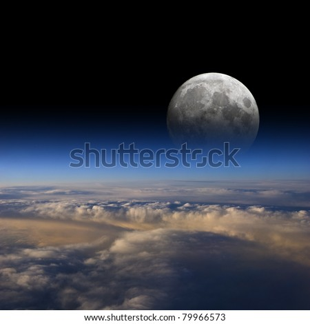 The Moon rises over planet Earth