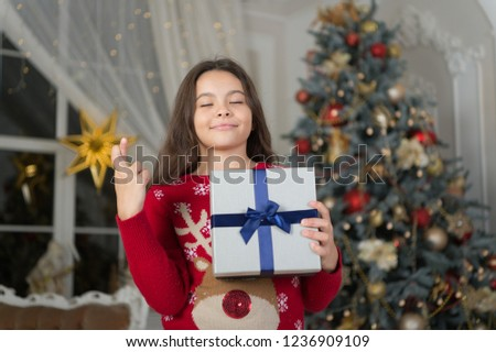 The morning before Xmas. New year holiday. Happy new year. small wishing and dreaming girl at christmas. Christmas. Kid enjoy the holiday. little child girl likes xmas present. best wishes. #1236909109