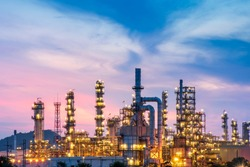 The morning landscape of petrochemical plants and oil refineries, natural gas storage tanks, industrial steel pipes with the blue sky background