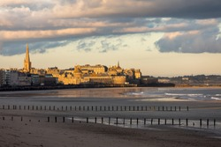 The morning light on the Plage du Sillon and walled city. Saint Malo , France, Ille et Vilaine, Emerald Coast