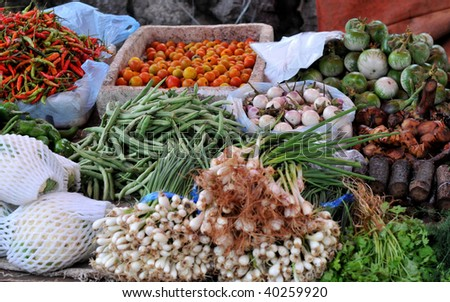 the morning market in luang prabang/laos:fresh fruits and exotic vegetables are sold here daily.