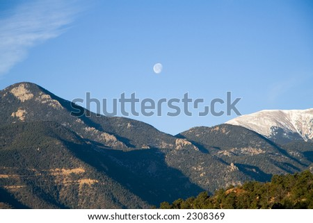 The morning moon over the Rockies, taken at the Garden of the Gods park in Colorado Springs.