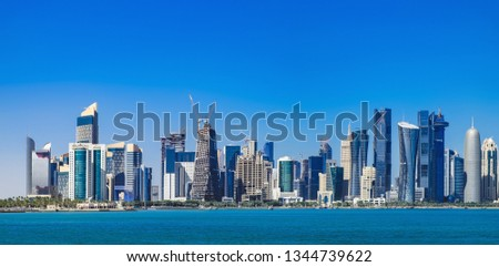 The morning panoramic view of the skyscrapers of Doha from the Persian Gulf. Futuristic skyline in the financial district of Qatar #1344739622