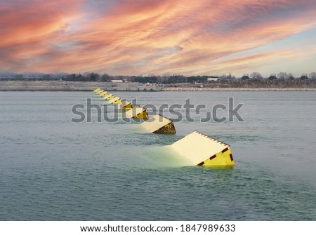 The MOSE System in Venice, Italy at the sunset for defense against high waters. Barrier against the high water in the defense of Venice Lagoon. New generation of industrial flood prevention system. Stock fotó ©