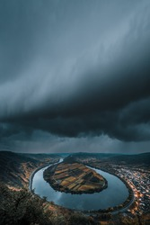 The Moselle loop, a beautiful river in Germany, makes a 180 degree loop. with vineyards and a great landscape and lighting in the morning